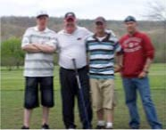 Dr. Droege (with club) coaches soldiers at the Ft Leonard Wood AUSA golf tournament.